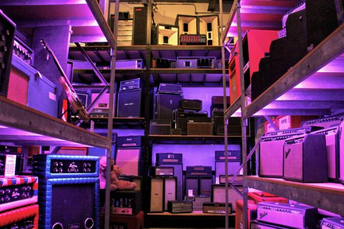 A warehouse space is crammed to the rafters with speakers