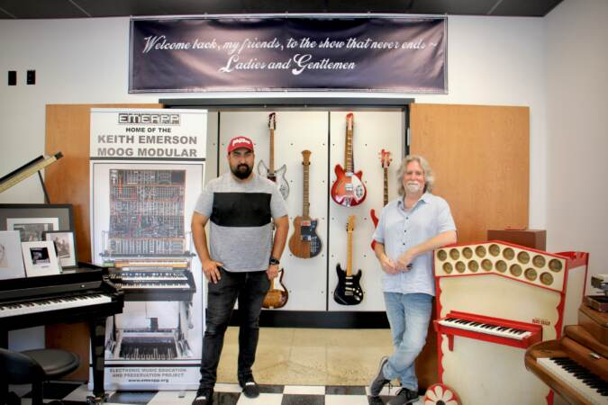 Vince Pupilio Jr. (left) and Drew Raison stand inside the Electronic Music Education and Preservation Project museum