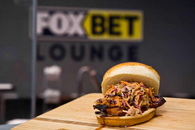 A grilled Korean chicken sandwich with kimchi slaw at the FOX BET lounge