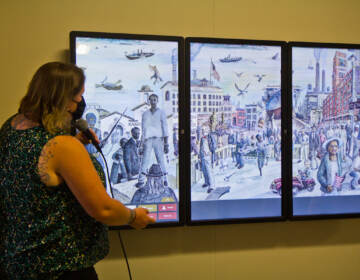 The city of Camden unveiled an historical, interactive mural at City Hall on August 12, 2021. (Kimberly Paynter/WHYY)