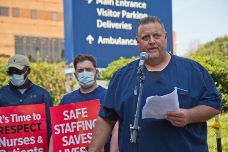 Kevin Diamond speaks outside Jefferson Hospital as part of a rally