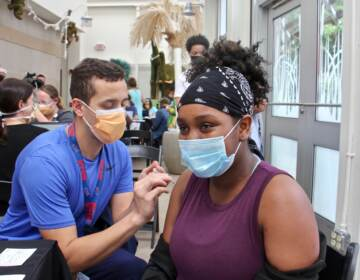 Zaliyah Dozier gets a COVID-19 vaccination at the Philadelphia Zoo