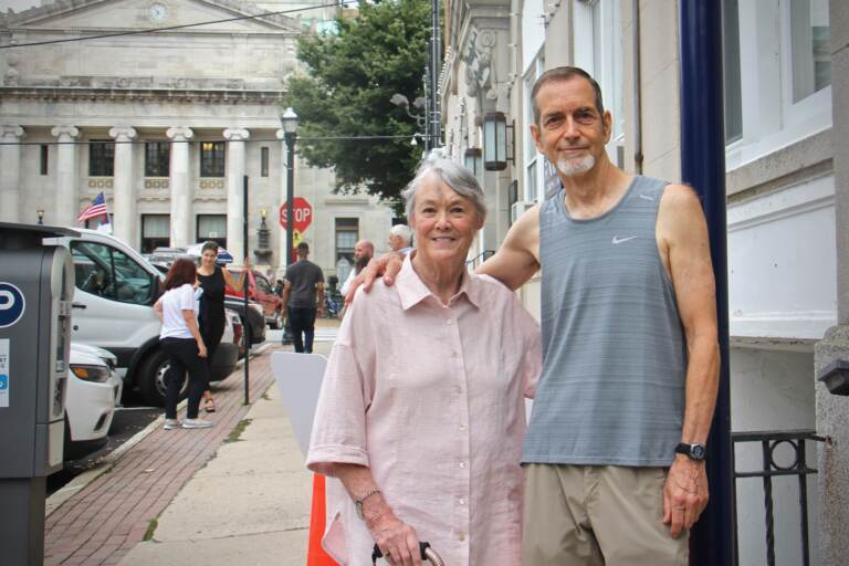 Fifty years ago, Bonnie Raines and Keith Forsyth were among a group of activists who broke into an FBI office in Media, Pa. and made off with classified documents exposing illegal FBI investigations. They are standing at the site where a historical marker will commemorate the break-in. (Emma Lee/WHYY)