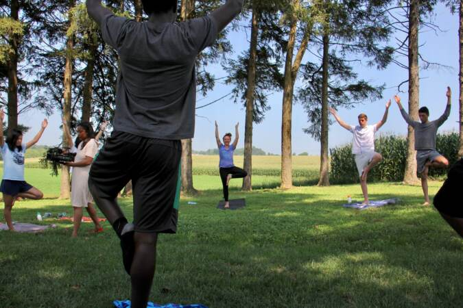 Students participate in an outdoor yoga class