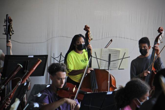 Bassist Lashawnna Levy practices with members of the Philadelphia Orchestra