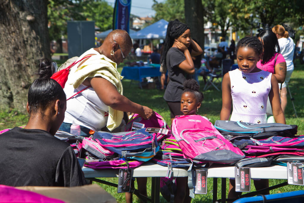 Families are given free backpacks and back-to-school supplies