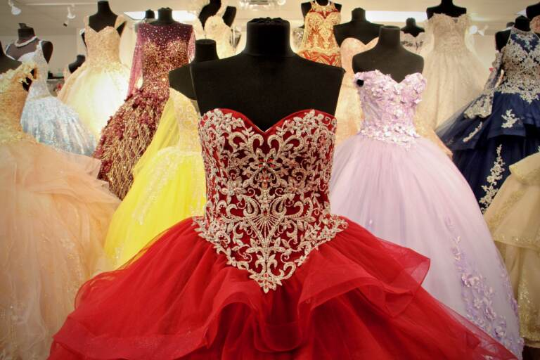 Quinceañera dresses dazzle in a crowded floor display