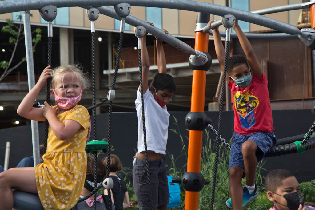 Elementary school students play on the playground