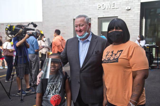 Julian Quann, 7, and his mom Sade Benson posed with Philadelphia Mayor Jim Kenney