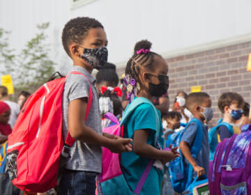 Students wear face masks outside of their school in Philly