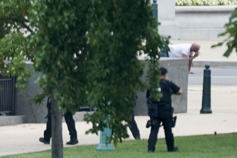 Floyd Ray Roseberry is apprehended after being in a pickup truck parked on the sidewalk in front of the Library of Congress' Thomas Jefferson Building