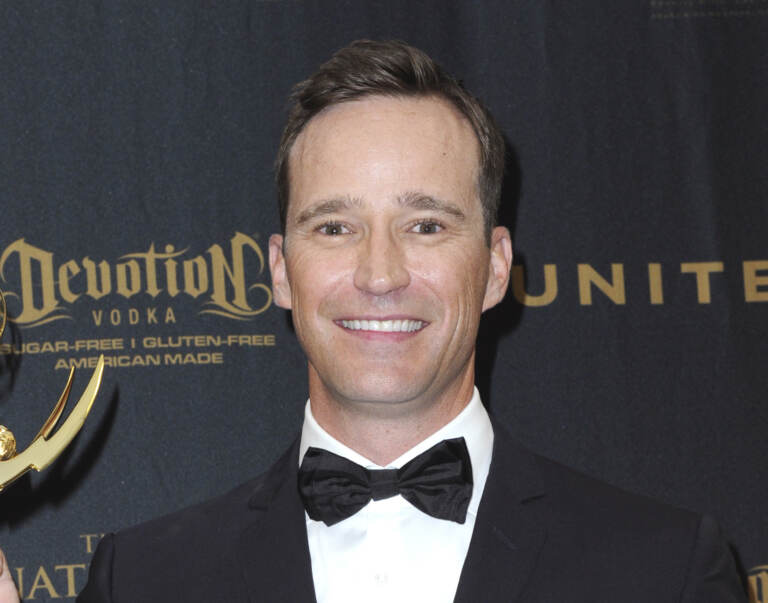 """Producer Mike Richards poses in the pressroom at the 43rd annual Daytime Emmy Awards on May 1, 2016, in Los Angeles. Richards stepped down as host of """"Jeopardy!"""" after a report about past misogynistic comments surfaced this week. (Photo by Richard Shotwell/Invision/AP, File)"""