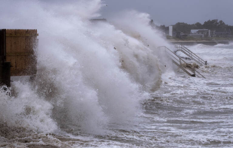 Waves pound seawall in Montauk, N.Y., Sunday, Aug. 22, 2021, as Tropical Storm Henri affects the Atlantic coast. (AP Photo/Craig Ruttle)