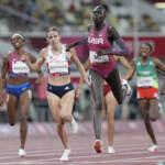 Athing Mu leads in the 800-meter race at the Olympics