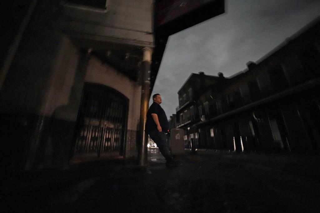 Greg Nazarko leans against a pole outside the Bourbon Bandstand bar after a storm