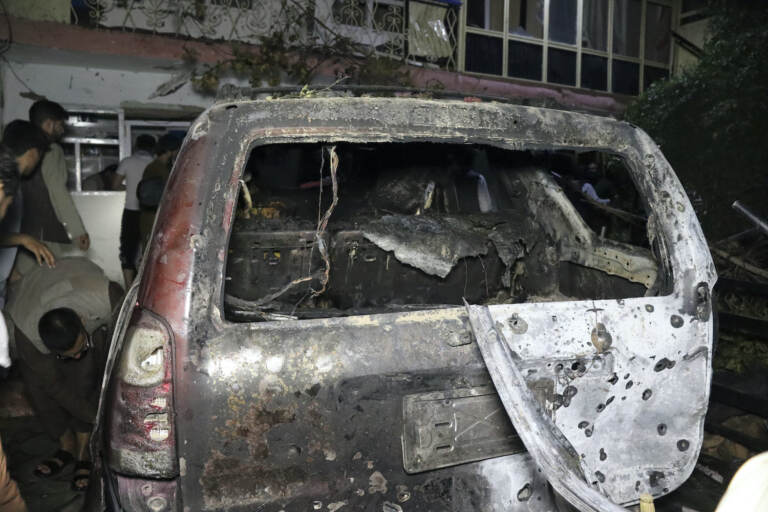 A destroyed vehicle is seen inside a house after a U.S. drone strike