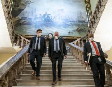Bernie Sanders walks towards the Senate floor
