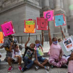 A group of kids from the Southwest Philadelphia Healthnastics program, ages 3-18, held signs at a protest demanding the Kenney administration do more to address gun violence in the city on August 4, 2021. (Kimberly Paynter/WHYY)