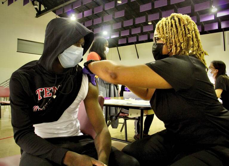 Nafis Smith, 17, gets his second COVID-19 shot.
