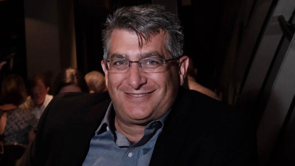 John Cofrancesc smiles for a photo
