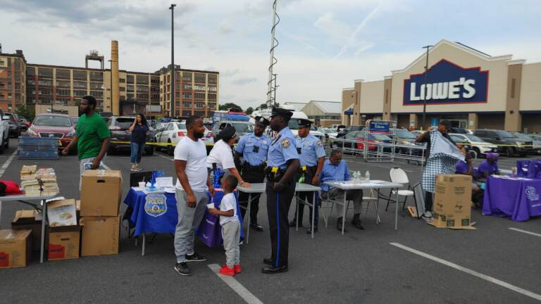 Marvin Ebron and son MJ speak to a police officer