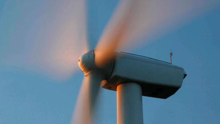 A closeup of an offshore wind turbine