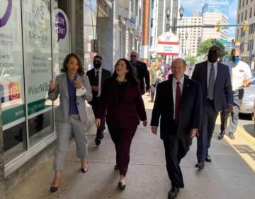 Isabella Casillas Guzman (center) tours tours downtown Wilmington businesses alongside U.S. Sen. Chris Coons and U.S. Rep. Lisa Blunt Rochester