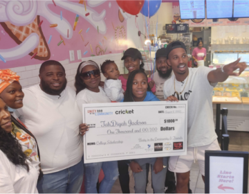 Unity in the Community surprised TahDiyah Jackson and her mother Ameena with a $1,000 scholarship. (Tom MacDonald/WHYY)