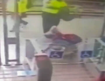 Security footage of a security guard striking another person at SEPTA's Allegheny Station. (6ABC)
