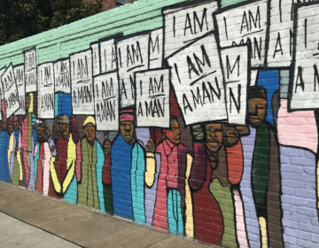 A mural depicts the 1968 sanitation worker strike in Memphis.