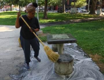 Rashonda Pinson cleans a portion of the park