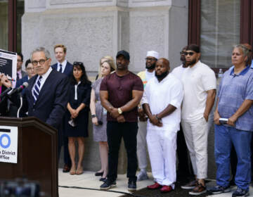 District Attorney Larry Krasner speaks during a news conference while standing with people who were exonerated, in Philadelphia, Tuesday, June 15, 2021. (AP Photo/Matt Rourke)