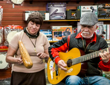 A woman and man playing music at Centro Musical