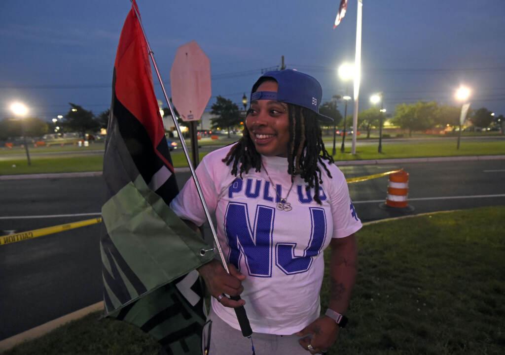 Lashay Alston holds a Black Lives Matter flag