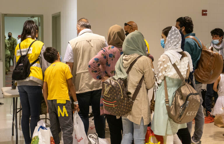 Afghan refugees arrive at PHL airport.