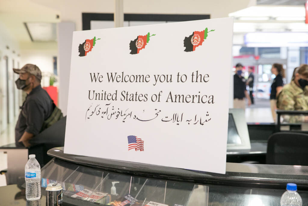 A sign welcomes Afghan refugees at PHL airport.