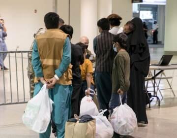 Afghan refugees arrive at Philadelphia international terminal.