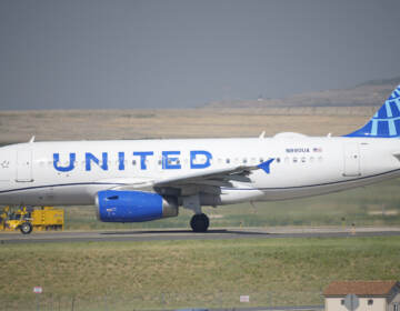 A United Airlines jetliner taxis down a runway for take off from Denver International Airport last month. The carrier has become the first major U.S. airline to require employees be vaccinated against COVID-19. (David Zalubowski/AP)