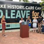 Nour Qutyan speaks at a Paid Leave for All rally
