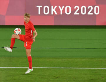 Canada's midfielder Quinn warms up prior to the Tokyo Olympics women's final soccer match between Sweden and Canada on Aug. 6. (Tiziana Fabi/AFP via Getty Images)