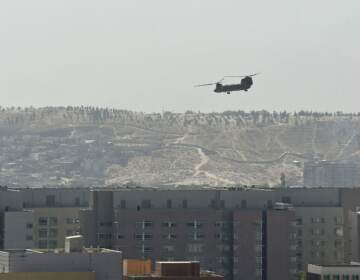 A U.S. military helicopter is pictured flying above the U.S. Embassy in Kabul