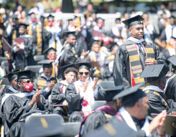 Students applaud at the Morehouse College commencement ceremony on May 16, 2021, in Atlanta. Morehouse recently announced it would clear remaining tuition balances for students, joining several other HBCUs doing the same. (Marcus Ingram/Getty Images)
