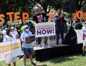 Demonstrators demand action on voting rights.