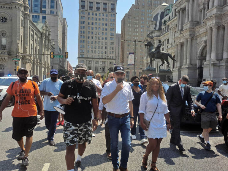Jamal Johnson, Larry Krasner, Jamie Gauthier, and others march in a protest against gun violence