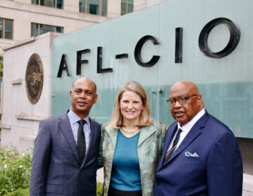 AFL-CIO officers (from left) Tefere Gebre, Liz Shuler and Fred Redmond stand in front of the federation's headquarters