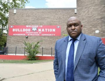 Leyondo Dunn stands outside Gratz high school