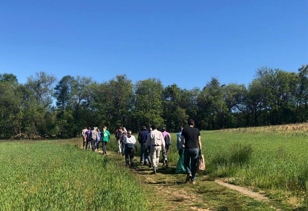 A group of volunteers hikes through a portion of White Clay Creek State Park