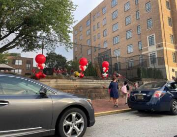 Students in Delaware are returning to fully open schools this week, like these kids heading into Ursuline Academy in Wilmington. (Cris Barrish/WHYY)