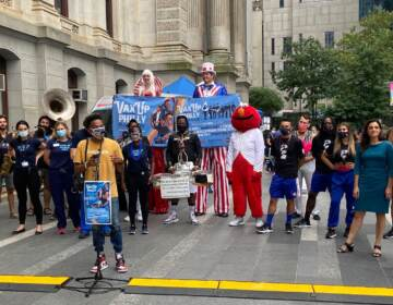Philadelphia residents and elected officials gather for the Vax Up Philly parade.