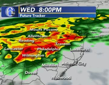 A weather map indicates downpours will produce flooding across the Philly region